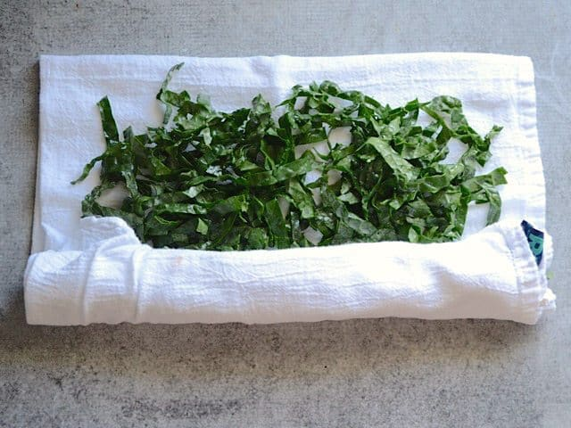 Kale being rolled up in a towel to dry