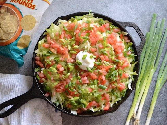 Lettuce, Tomato, Green Onion, and sour cream added to the skillet