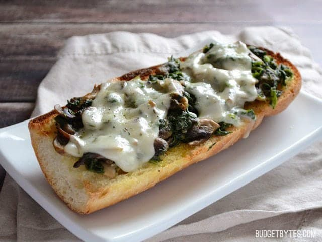 Mushroom Spinach and Swiss French Bread Pizzas - BudgetBytes.com