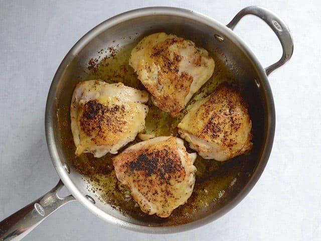 Brown Chicken Thighs in the skillet