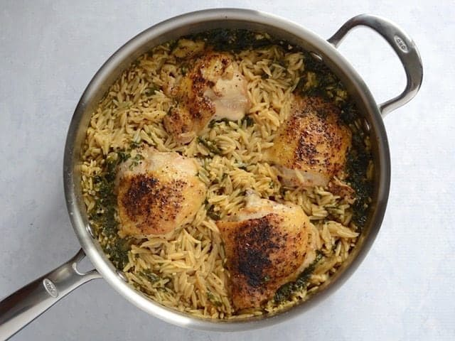 Cooked Chicken and Orzo in the skillet