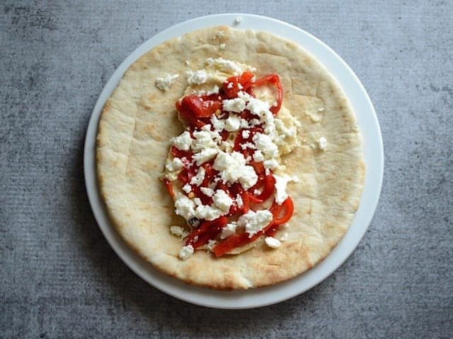 Red Peppers and Feta added on top of hummus