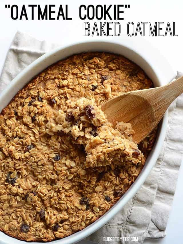 A casserole dish full of oatmeal cookie baked oatmeal with a wooden spoon scooping some from the side