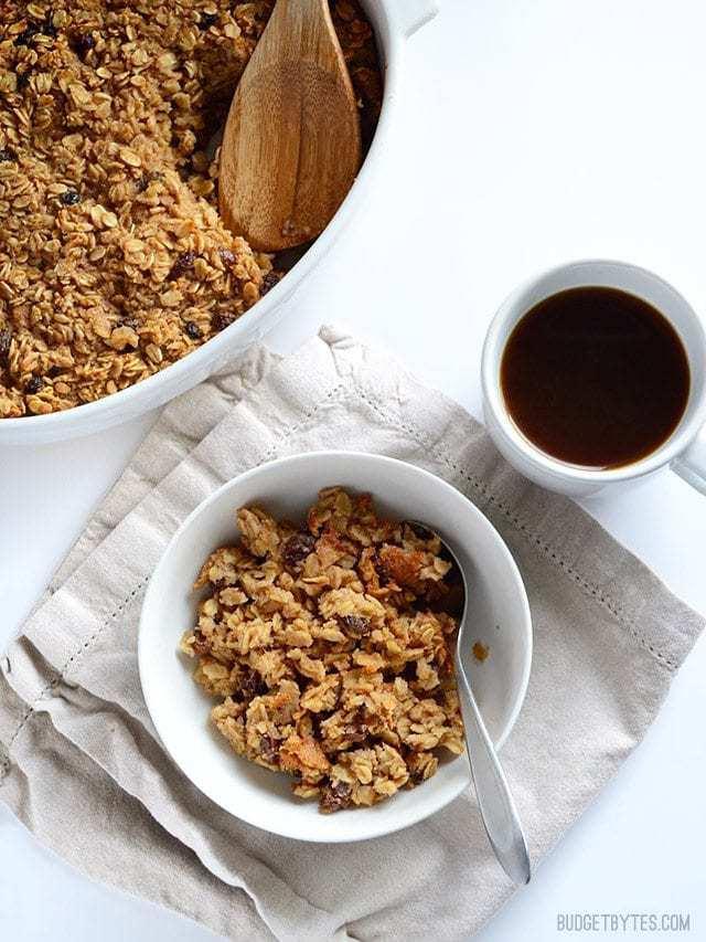 """Oatmeal Cookie"" Baked Oatmeal served into a bowl, mug of coffee on the side"