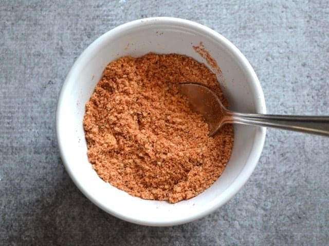 Smoky Parmesan spice mix in a bowl with a spoon
