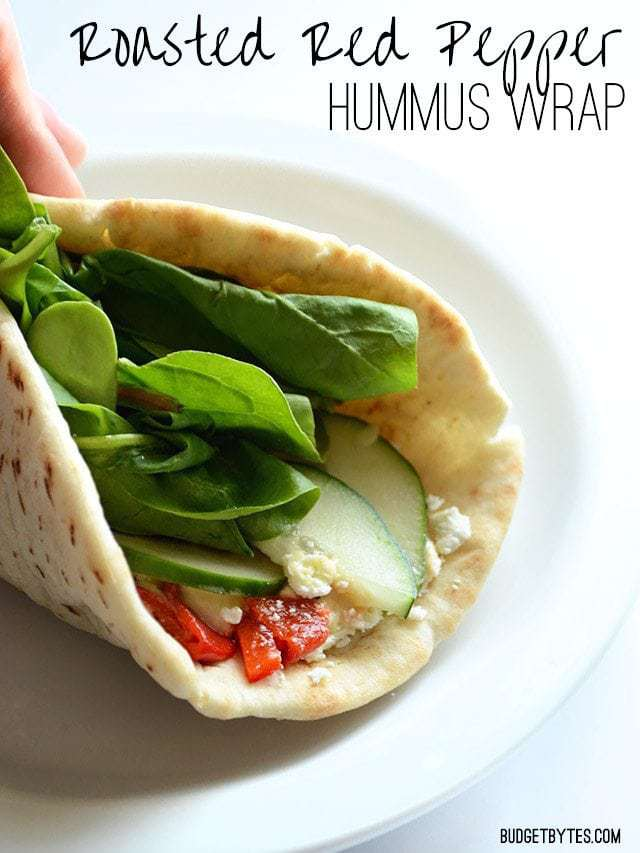 Close up of the end of a Roasted Red Pepper Hummus Wrap, title text at the top
