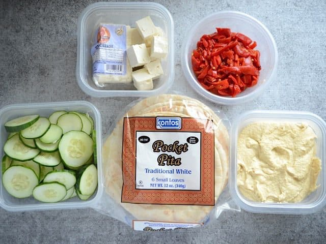 Ingredients for hummus wraps in individual containers