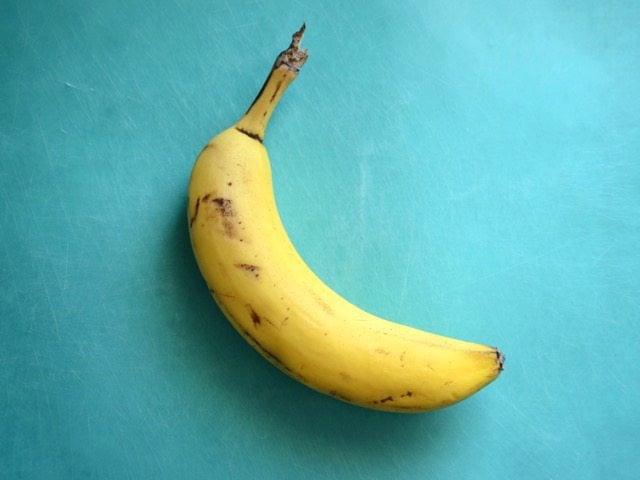 A Ripe Banana on a blue cutting board