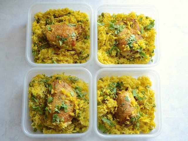 Yellow Rice Chicken Skillet divided into plastic meal prep containers