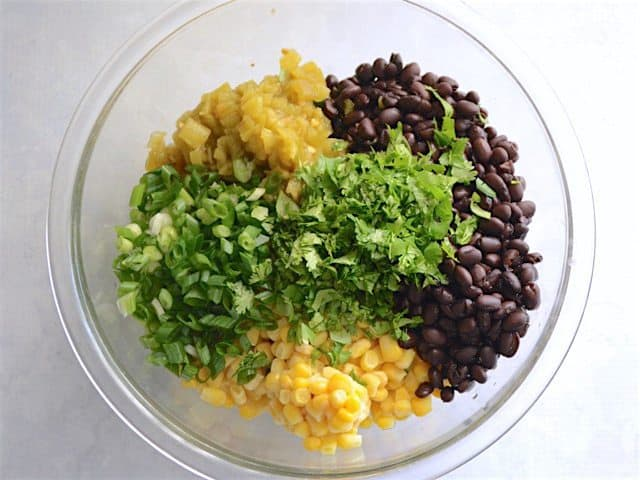 Enchilada Casserole Filling ingredients in a glass bowl