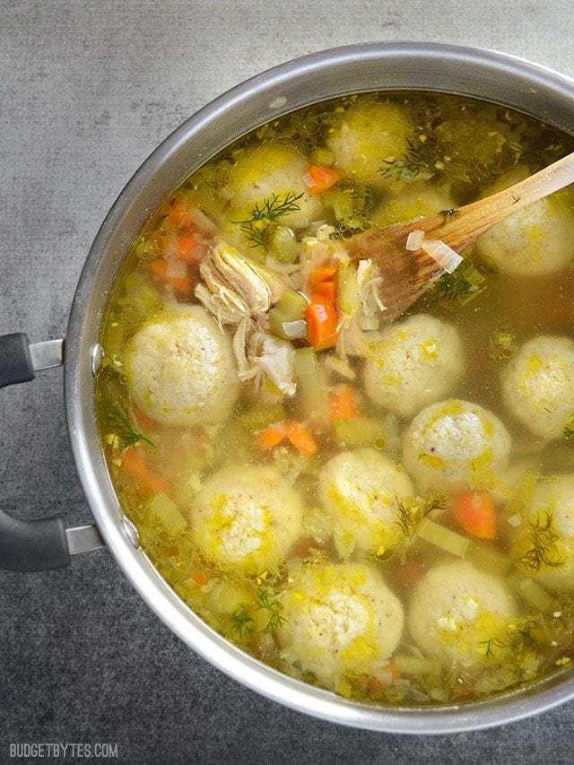 Close up of Matzo Ball Soup in pot