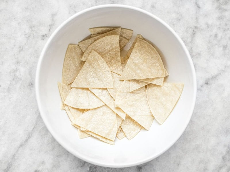 Coat Tortillas in Oil by tossing in a bowl