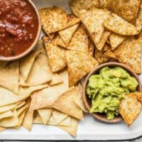 These Homemade Baked Tortilla Chips are fast, easy, super crunchy, a great way to use up leftover tortillas, and a great alternative to store bought chips. Budgetbytes.com