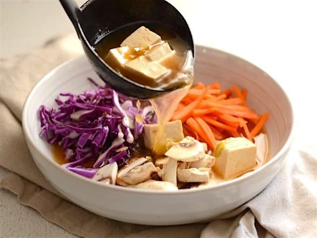 Pour Broth Over Vegetables