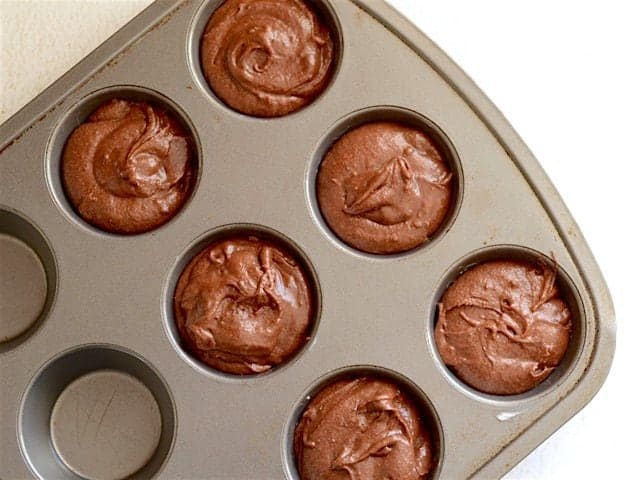 Brownie Batter in a Muffin Tin and Ready to Bake