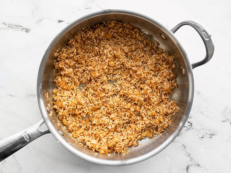 Cooked rice and spices in skillet