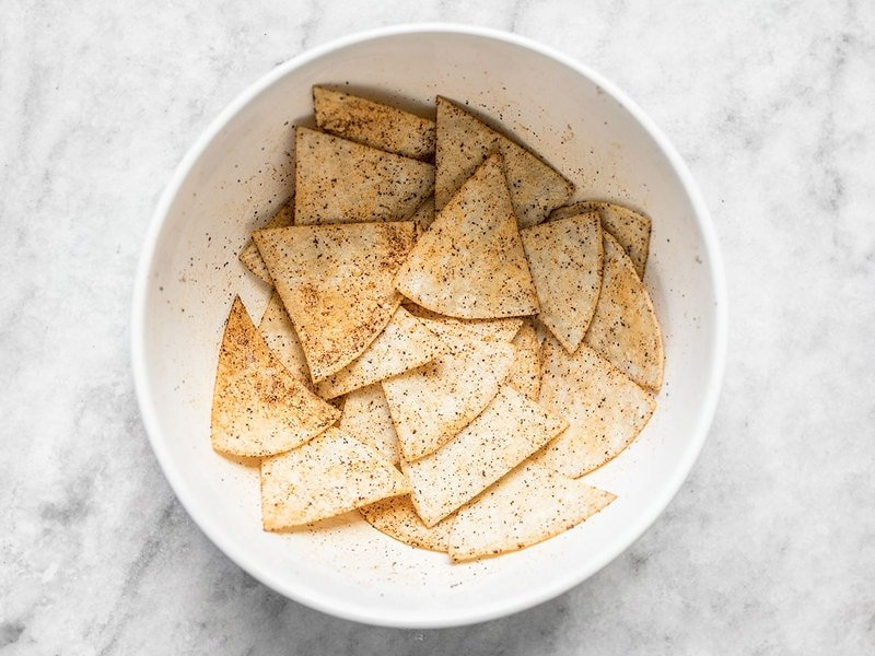 Coat oiled tortilla wedges in spices