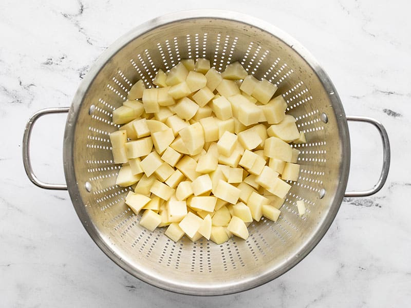 Diced potatoes in a colander