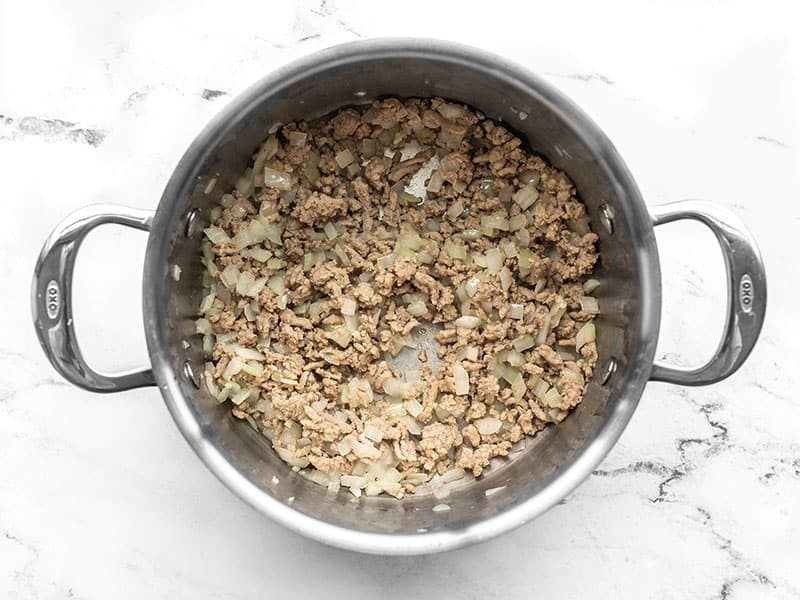 Cooked ground turkey, onion, and garlic in a pot