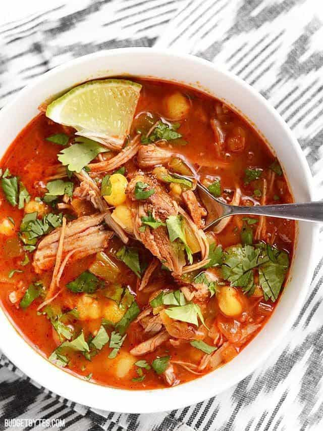 Close up view of 30 minute posole with lime and cilantro toppings.
