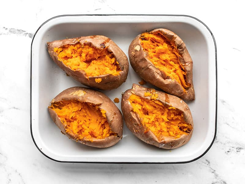 Opened and mashed sweet potatoes in the baking dish