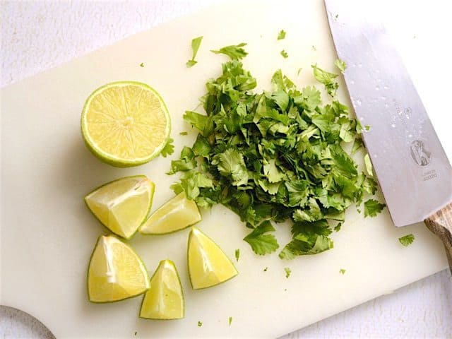 Cilantro and Lime on a cutting board with a knife