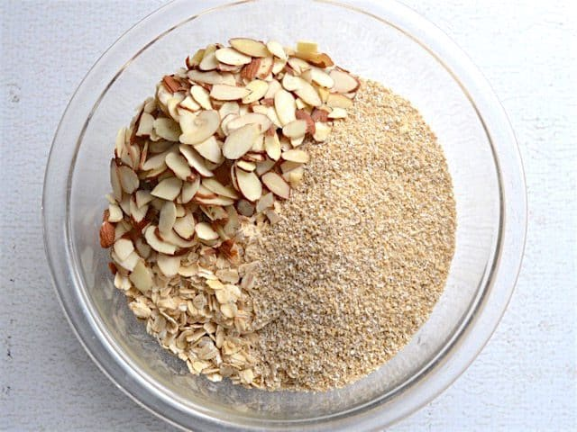Oats, oat bran, and almonds in a glass bowl