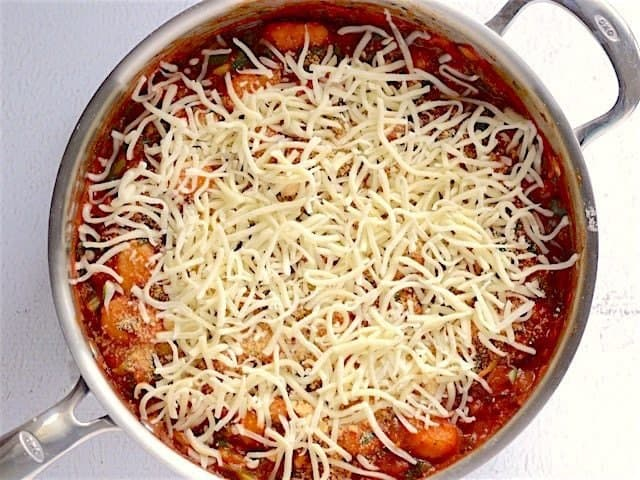 Skillet topped with mozzarella
