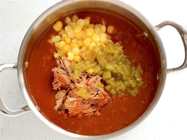 Pork, Hominy, and Chiles added to the soup pot