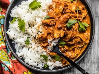 This Slow Cooker Chicken Tikka Masala boasts a rich and aromatic sauce, and tender juicy chicken. Make four servings for the price of one take out! Budgetbytes.com