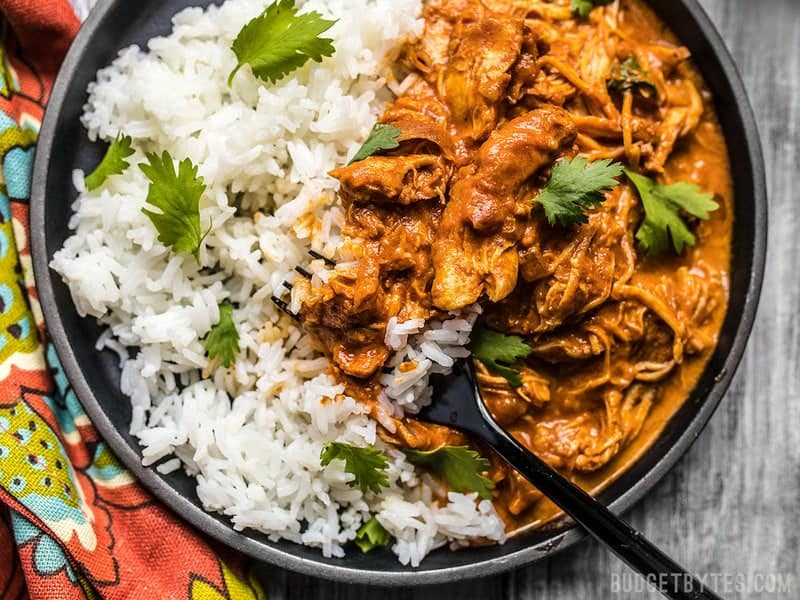 Close up view of Slow Cooker Chicken Tikka Masala on a plate with rice.