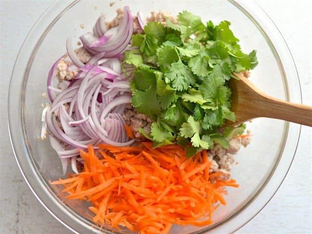 Vegetables added to seasoned pork
