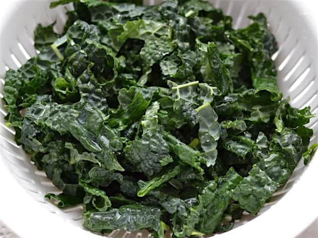 Chopped Lacinato Kale in a colander after being rinsed