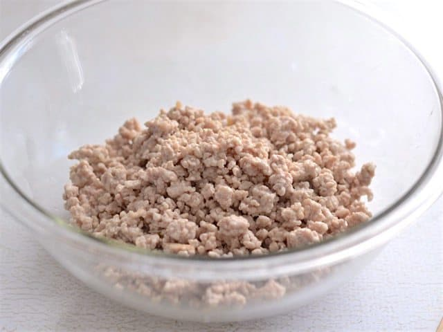 Cooked Ground Pork in a glass bowl