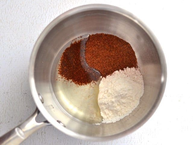 Chili powder, flour, and oil in sauce pot