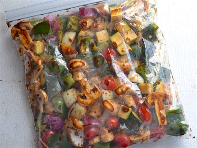 Chopped vegetables marinating in a large zip top bag