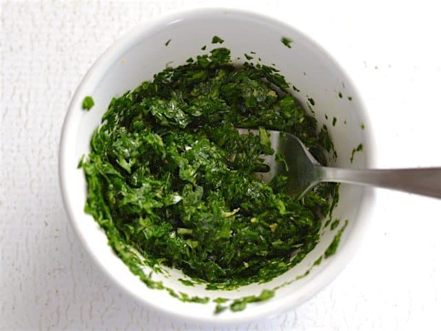 Parsley Lemon Mix in a small white bowl with a fork