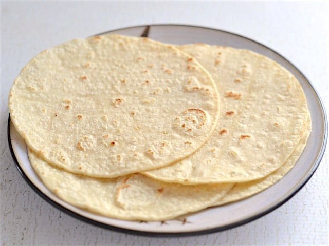 toasted corn tortillas on a plate