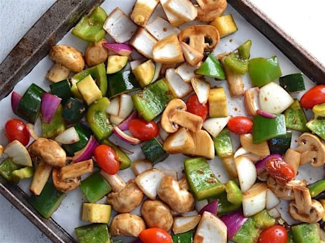 Marinated vegetables Ready on a parchment lined baking sheet to Broil