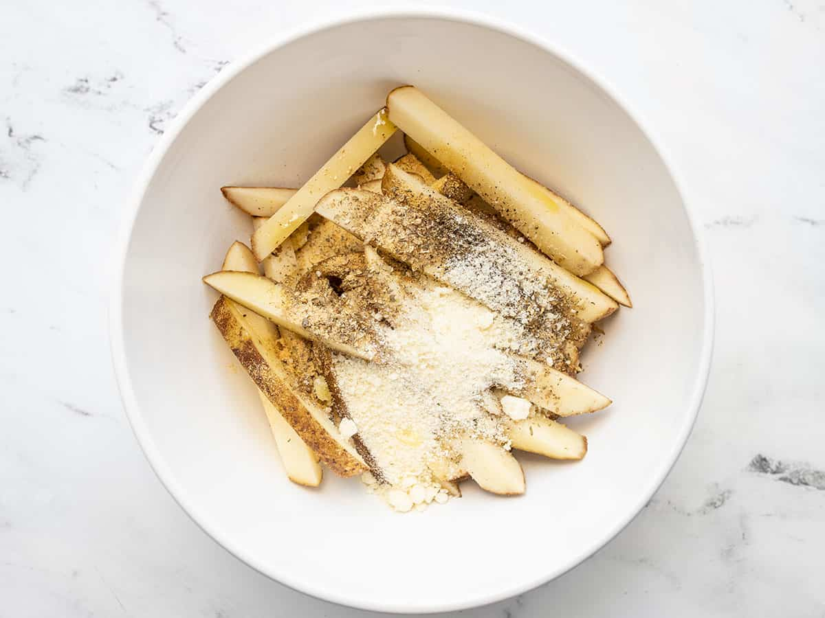 Cut potatoes in a bowl with seasoning
