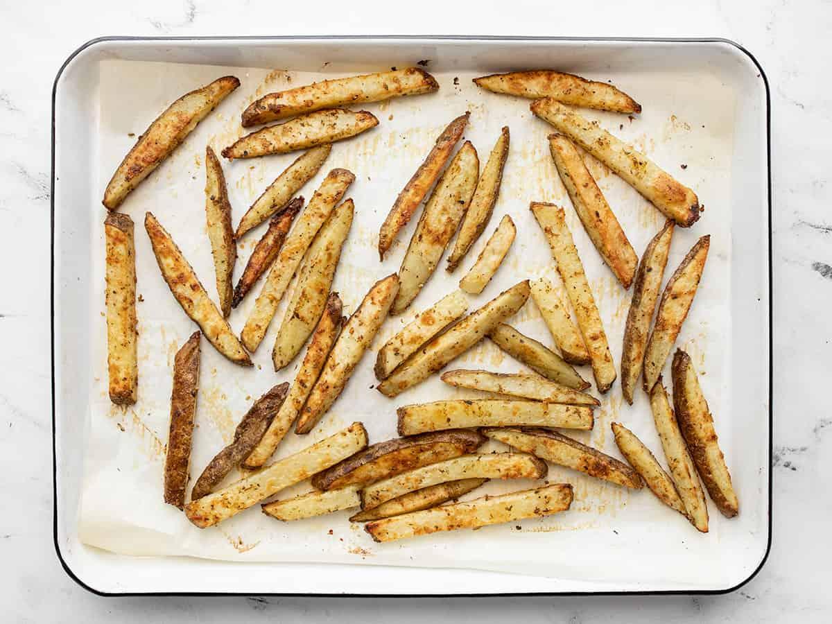 baked garlic parmesan fries on the baking sheet