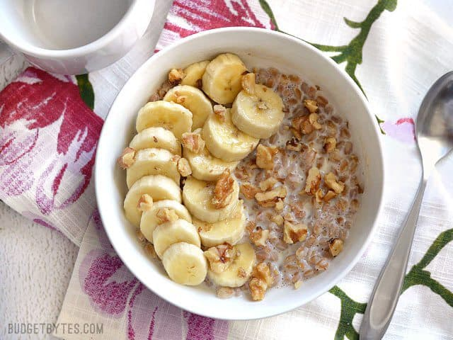A bowl of Banana Nut Breakfast Farro with banana and walnuts, ready to be eaten