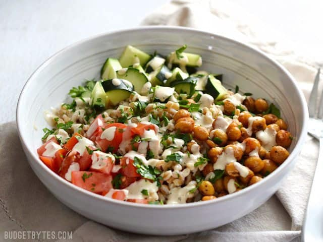 This Mediterranean Farro Salad with Spiced Chickpeas is packed with flavor, texture, and nutrients (and no animal products!). BudgetBytes.com