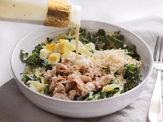 Add Dressing to Kale & Salmon Caesar Salad