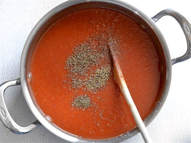 Herbs added to soup pot
