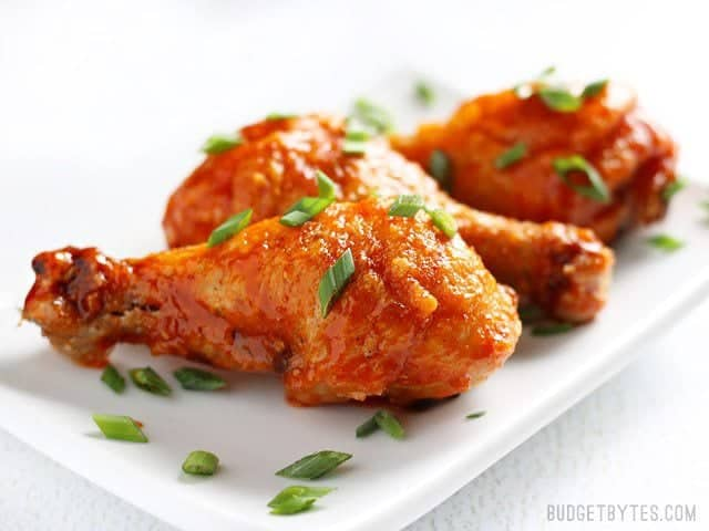 Crispy Baked Honey Sriracha Chicken Drumsticks with Homemade Honey Sriracha Wing Sauce - BudgetBytes.com