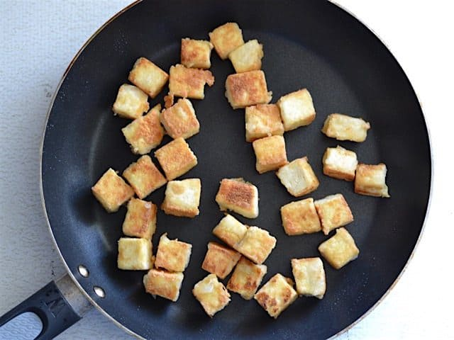 Fried cubed Tofu in a skillet