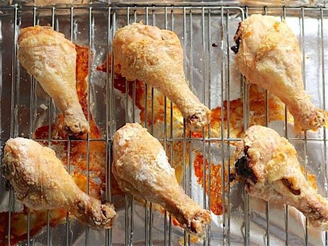 Golden Baked Chicken Drumsticks on the baking sheet