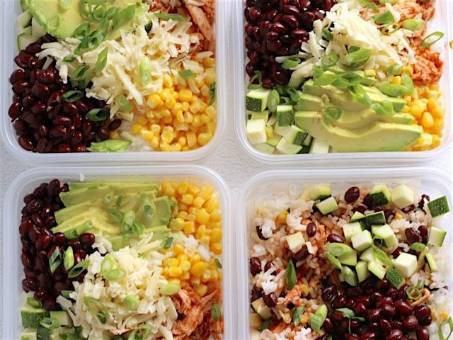 BBQ Chicken Burrito Bowls in four square plastic meal prep containers
