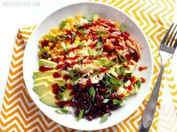 Build BBQ Chicken Burrito Bowls are an easy, customizable lunch option that is great both hot or cold! BudgetBytes.com